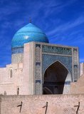 The Kalyan Mosque is Bukhara's congregational mosque or Friday Mosque. It was built in the 16th century on the site of an older mosque destroyed by Genghis Khan.<br/><br/>   The Kalyan minaret or Minâra-i Kalân (Pesian/Tajik for the 'Grand Minaret') is part of the Po-i-Kalyan mosque complex and was designed by Bako and built by the Qarakhanid ruler Arslan Khan in 1127.<br/><br/>  The minaret is made in the form of a circular-pillar brick tower, narrowing upwards, with a diameter of 9m (30ft) at the bottom, 6m (20ft) at the top and a height of 46m (150ft) high.<br/><br/>  The Kalyan Minaret is also known as the 'Tower of Death', as for centuries criminals were executed by being tossed off the top.<br/><br/>  Bukhara was founded in 500 BCE in the area now called the Ark. However, the Bukhara oasis had been inhabitated long before.<br/><br/>  The city has been one of the main centres of Persian civilization from its early days in 6th century BCE. From the 6th century CE, Turkic speakers gradually moved in.<br/><br/>  Bukhara's architecture and archaeological sites form one of the pillars of Central Asian history and art. The region of Bukhara was for a long period a part of the Persian Empire. The origin of its inhabitants goes back to the period of Aryan immigration into the region.